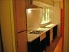 overzicht keuken met uitgifteluik